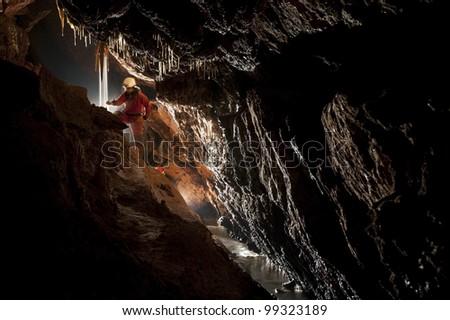 Cave explorer, speleologist exploring the underground - stock photo