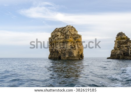 Caves and rock formations at Dona Ana Beach , Algarve coast, Portugal - stock photo