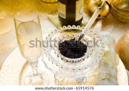 caviar and champagne over luxury table - stock photo