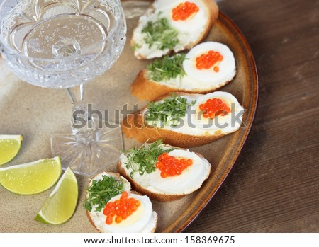 Caviar canapes with cream cheese, egg and cress - stock photo