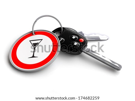 Cay keys with traffic sign keyring. Concept for traffic signals and rules of the road. - stock photo