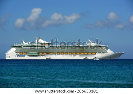 CAYMAN ISLANDS - DEC 30: Royal Caribbean International Cruise ship Independence of the Seas anchor offshore on December 30th, 2014 in George Town, Cayman Islands.