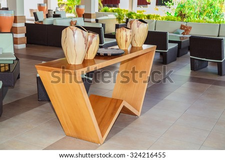 Cayo Coco island, Pestana,  Cuba, Sep 2, 2015 nice modern stylish lobby bar interior with closeup view of natural wood stand table and gorgeous beautiful  decorated vases