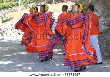 CAYO LEVANTADO, DOMINICAN REPUBLIC - APRIL 9: Unidentified women perform a traditional dance as they greet visitors to their Caribbean island on April 9, 2011 in Cayo Levantado, Dominican Republic. - stock photo