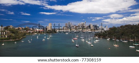 CBD city sydney summer sunny day view over harbour bay under blue sky with white clouds