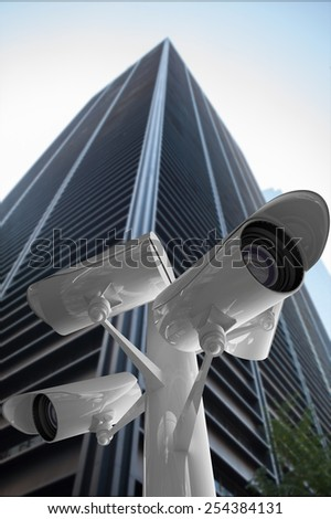 CCTV camera against low angle view of skyscraper