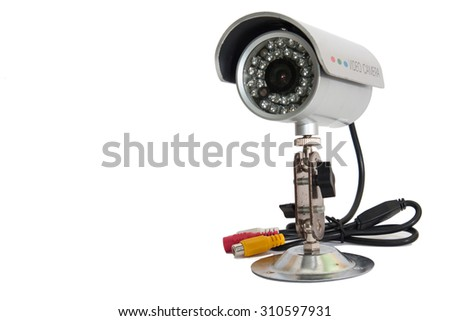 CCTV camera for video surveillance on the metal stand. - stock photo