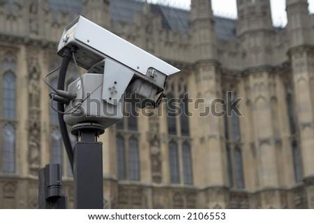 CCTV camera near historic building (Westminster abbey) - stock photo