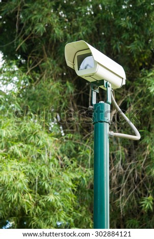 CCTV camera on green pole stand in the park for outdoor security