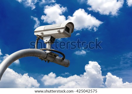 CCTV camera on  sky with clouds background.
