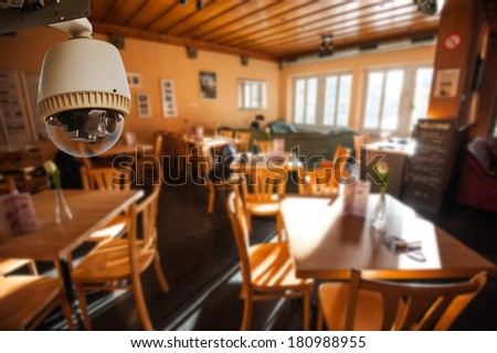 CCTV Camera Operating in Living room or restaurant - stock photo