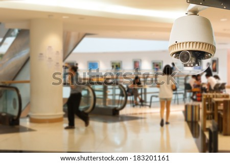 CCTV Camera Operating inside an art gallery or museum - stock photo