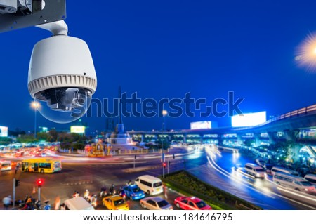 CCTV Camera Operating on road detecting traffic - stock photo