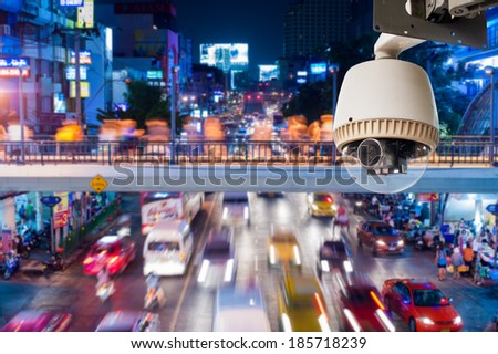 CCTV Camera Operating on traffic road - stock photo