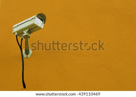 CCTV camera or surveillance installed on wall - stock photo