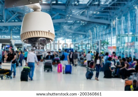 CCTV camera or surveillance operating in air port - stock photo