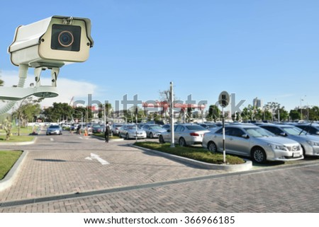 CCTV Camera or surveillance operating on garage - stock photo