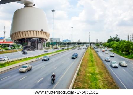 CCTV Camera or surveillance Operating on traffic road - stock photo