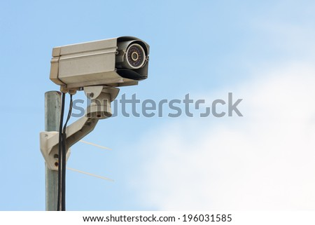 CCTV Camera or surveillance Operating with blue sky on background