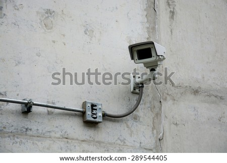 CCTV camera or surveillance operating with electric door in back