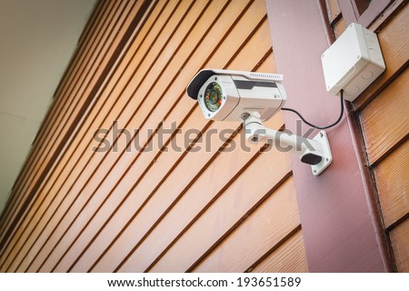 cctv camera security on wall background for safety concept - stock photo