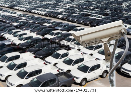 CCTV camera with auto storage yard - stock photo