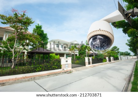 CCTV Camera with house in background - stock photo