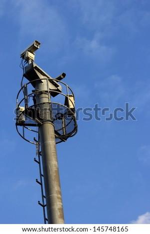CCTV cameras on high towers. - stock photo