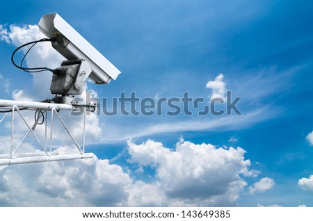 CCTV cameras on high towers. The the background is sky.