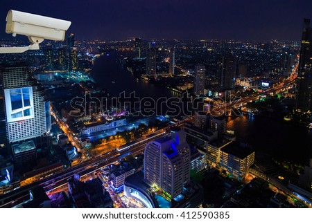 CCTV cameras with background of night city - stock photo