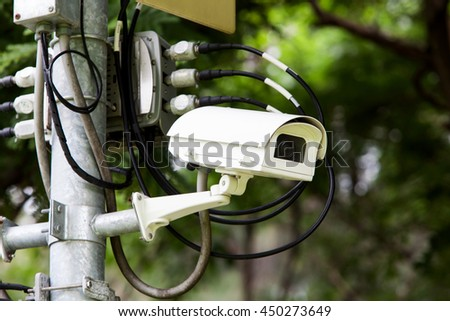 CCTV in the park for safety of people. - stock photo