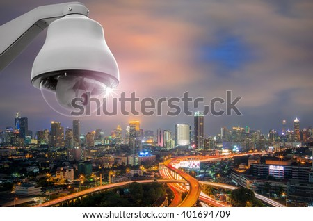 CCTV monitoring, security cameras. Backdrop with views of the city during twilight. - stock photo