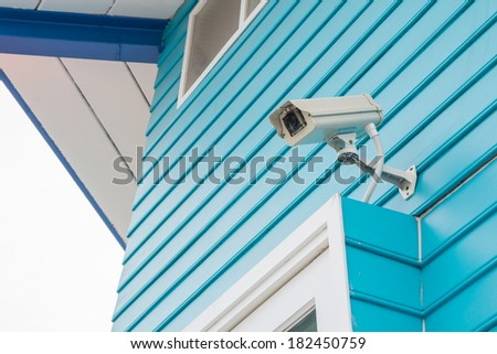 CCTV on Blue wood floor and the sky is white - stock photo