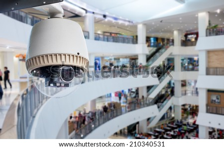 CCTV or surveillance Camera Operating inside department store - stock photo