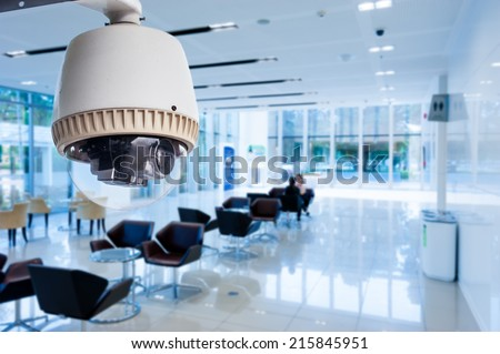 CCTV or surveillance operating in office building - stock photo