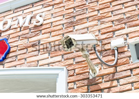CCTV security camera at the wall soft focus - stock photo