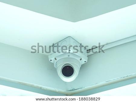 CCTV security camera in building - stock photo