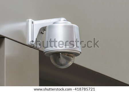 CCTV security camera. Monitoring in London street.