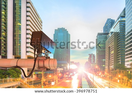 CCTV Security Camera or surveillance Operating on traffic road in sunset - stock photo