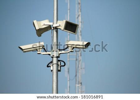 CCTV & speaker on the pole - stock photo