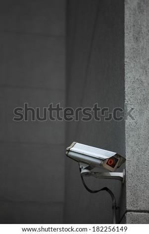 CCTV Surveillance Camera on a building Wall - stock photo