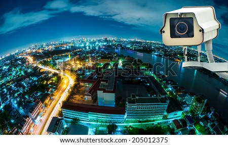CCTV with Blur City in background fish eye perspective - stock photo