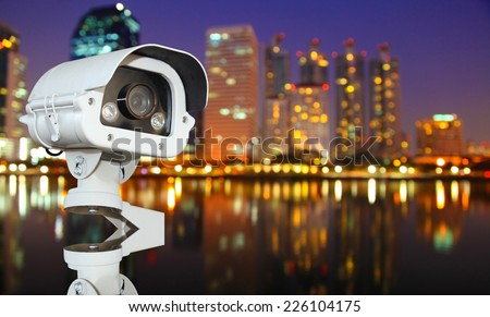 CCTV with Blurring City in night background.  - stock photo