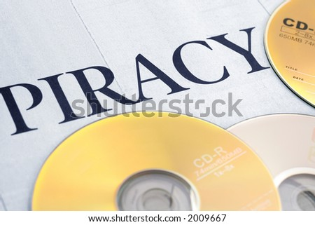 cd and word of piracy, concept of illegal copy - stock photo