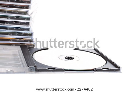 CD box open ahead of cds stack over a white background - stock photo