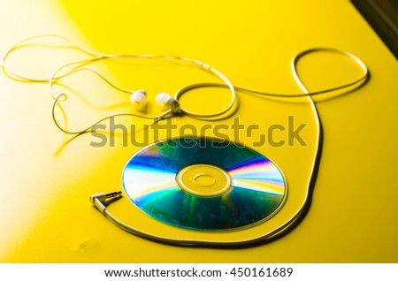 CD disc and headphone - stock photo