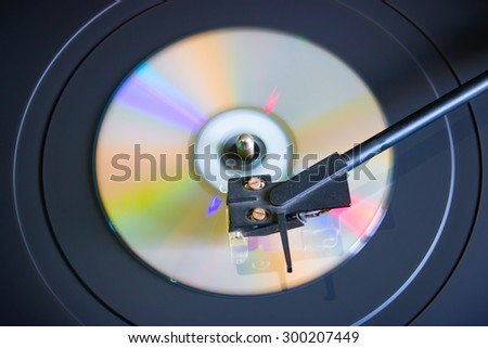 cd disc on a turntable top view selective focus - stock photo