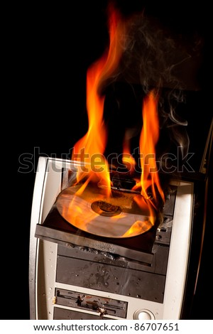 CD drive and entire computer on fire - stock photo