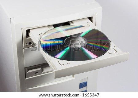 CD/DVD being being inserted into a computer. - stock photo