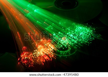 CD DVD data discs and fibre optique - stock photo